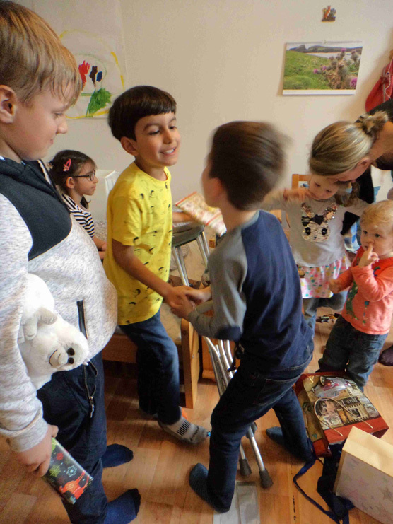 Rick's grandson, Konrad, shaking hands with friends at the celebration of his eighth birthday