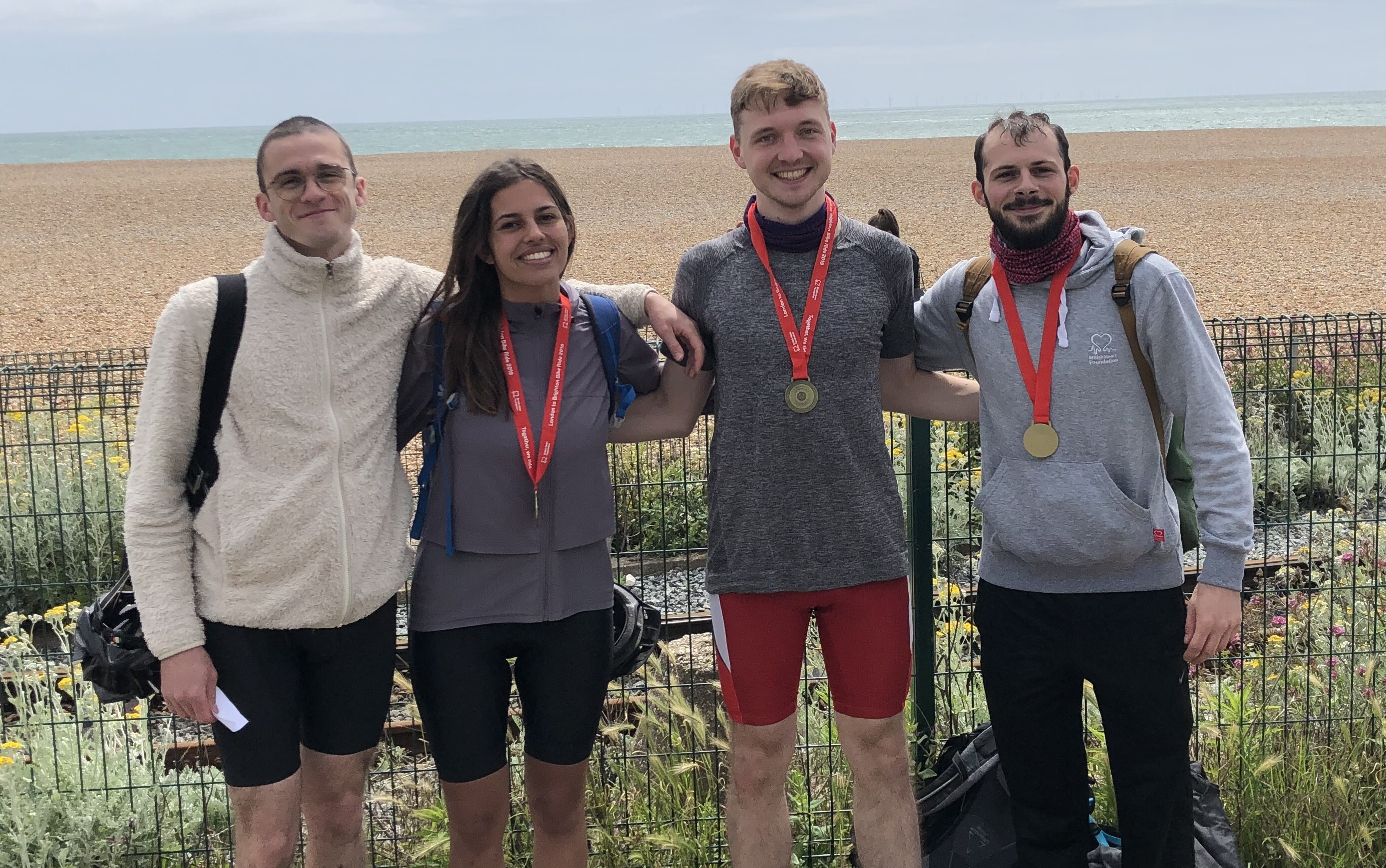BHF Alumna Ella Reed with colleagues after completing the London 2 Brighton Bike Ride