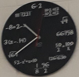 A clock with mathematical symbols