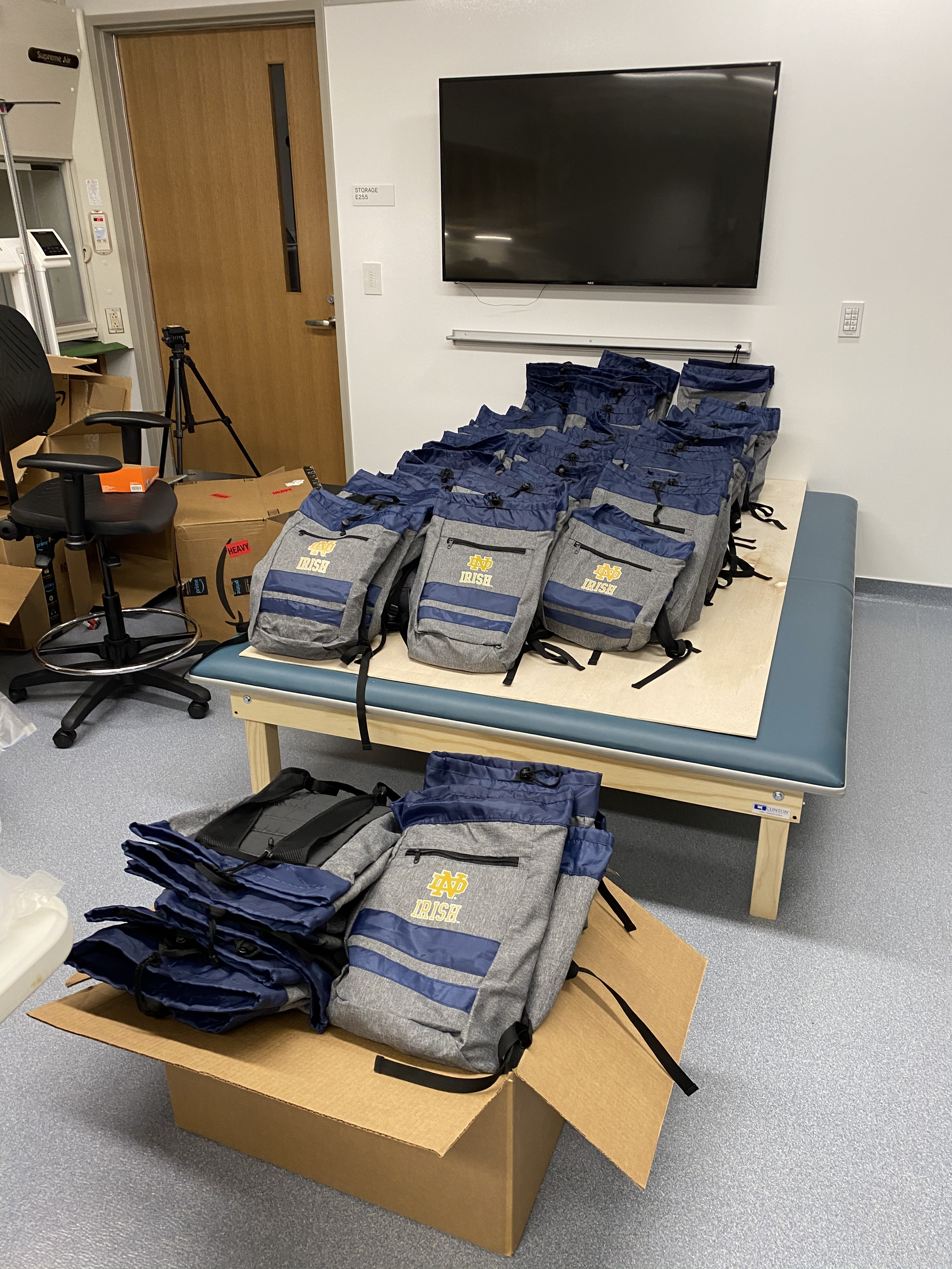 Notre Dame backpacks assembled with the science kits prepared for the K-6 students at St. Adalbert's
