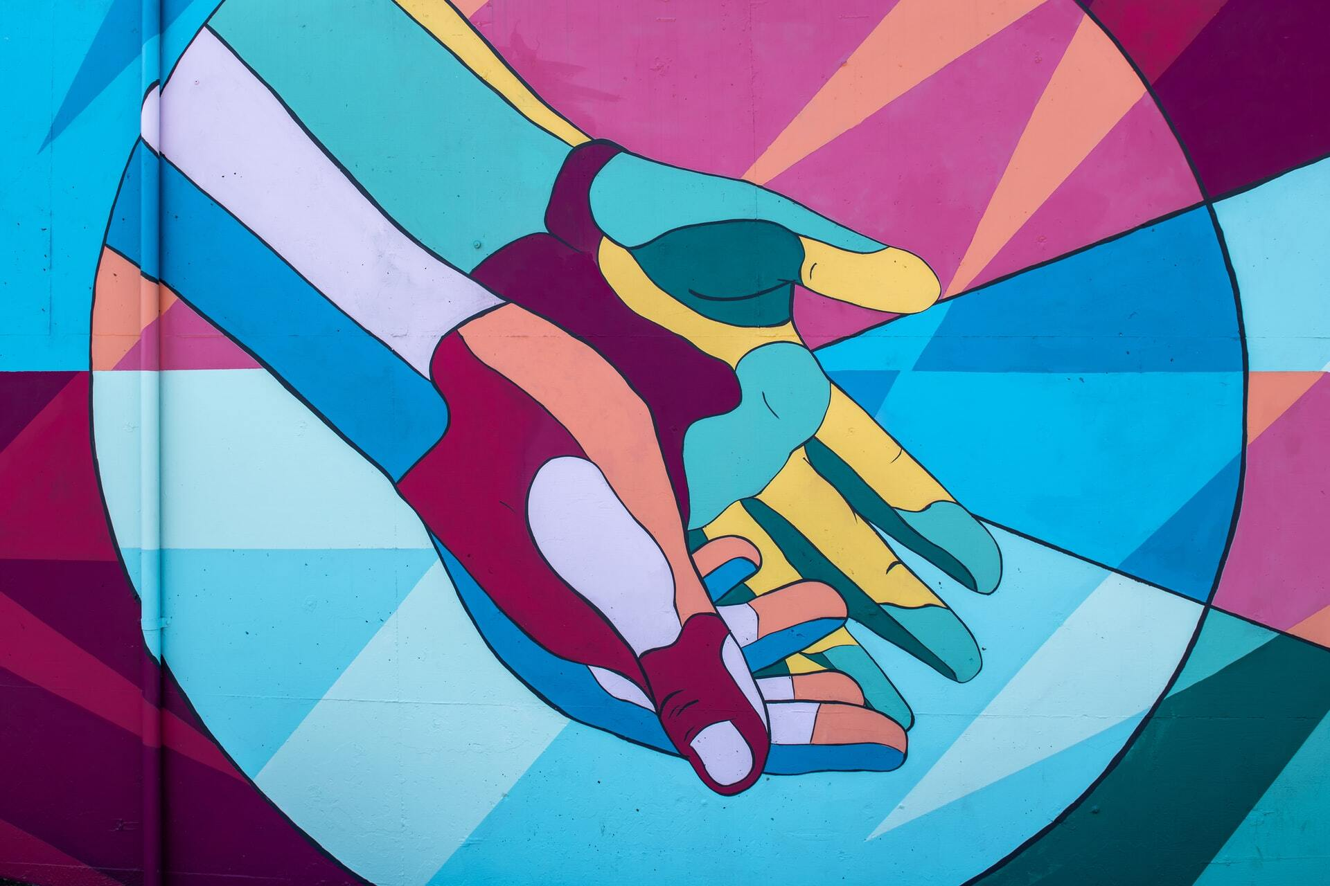 A painting of two hands kindly sharing something