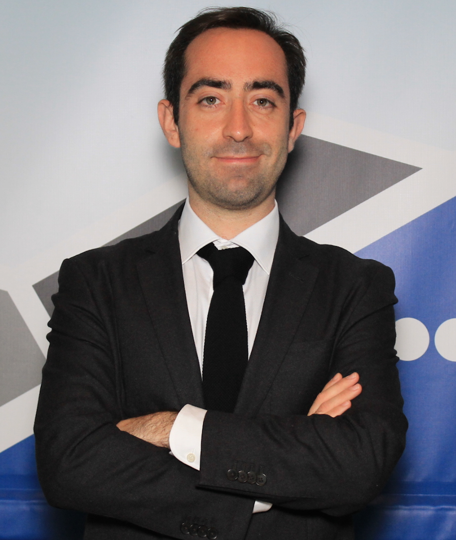 Lindau Alumnus Stefano Sandrone in a suit, arms crossed